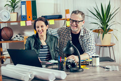 Two hipster managers working on laptop Royalty Free Stock Photo