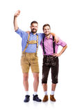 Two hipster men in traditional bavarian clothes, studio shot Stock Photography