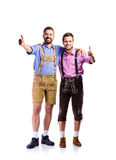 Two hipster men in traditional bavarian clothes, studio shot Royalty Free Stock Images