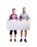 Two hipster men in traditional bavarian clothes, studio shot Stock Photo