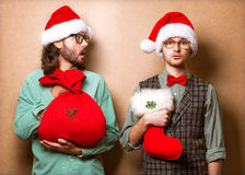 Two hipster in Santa Claus Royalty Free Stock Photography