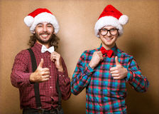 Two hipster in Santa Claus Stock Photography