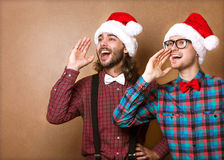 Two hipster in Santa Claus Royalty Free Stock Images