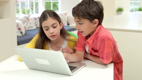 Two Hispanic Children Using Laptop At Home. Boy and girl using laptop at home together.Shot on Canon 5d Mk2 with a frame rate of 25fps stock video