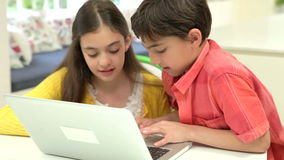 Two Hispanic Children Using Laptop At Home stock footage