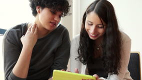 Two hispanic students with tablet pc Stock Photo
