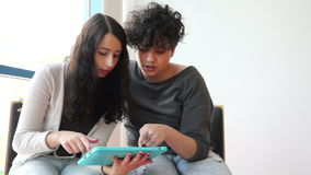 Two hispanic students with tablet pc stock video footage