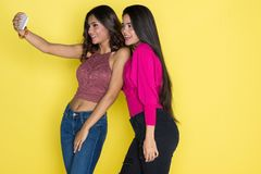 Two Hispanic Teen Sisters Royalty Free Stock Photo