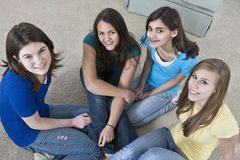 Two hispanic teenage girls with girlfriends at home Royalty Free Stock Image