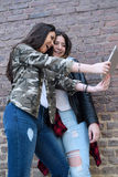 Two hispanic women taking a selfie with a tablet Royalty Free Stock Photos