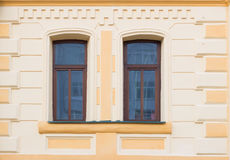 Two historic brown window on the yellow wall Stock Photo