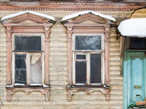 Two historic brown window on the yellow wall Royalty Free Stock Image