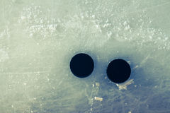 Two hockey puck Stock Photo