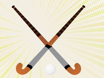 Two hockey sticks crossed and a ball Stock Photo