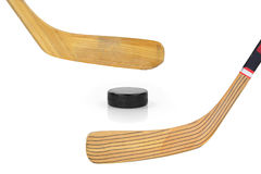 Two hockey sticks and puck Royalty Free Stock Photos