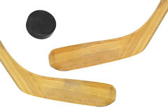 Two hockey sticks and puck Stock Photography