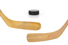Two hockey sticks and puck Royalty Free Stock Image