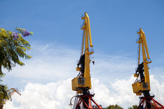 Two hoisting cranes Stock Photos