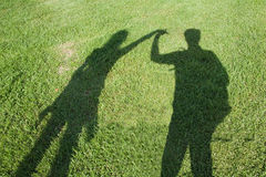 Two holding hands. Shadow of couple with holding hands Royalty Free Stock Photo