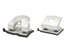 Two hole punchers isolated. Two metal office hole punchers isolated in white Stock Image