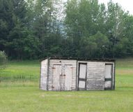 Two-Holer Plus. An aging old shed/ outhouse along Route 9N in Corinth, New York Stock Photography