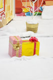 Two holiday gifts lie in the snow Stock Photography