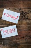 Two Holiday Note on Wooden Board Royalty Free Stock Images