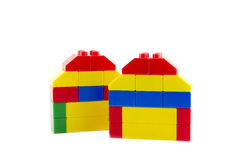 Two home icon made from plastic building blocks isolated Stock Image
