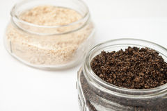 Two homemade bath scrubs. On white surface stock image