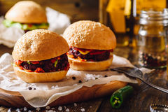 Two Homemade Beefburgers. Two Homemade Beefburgers with Hot Green Pepper Royalty Free Stock Photo