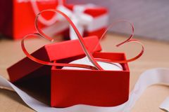 Two homemade paper red hearts in a red gift box, Symbol of Valentine`s Day. Two homemade paper red hearts in a red gift box. Symbol of Valentine`s Day royalty free stock photos