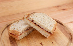 Two homemade peanut butter and jam sandwiches Royalty Free Stock Photo