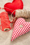Two homemade sewed red cotton love hearts. Royalty Free Stock Photos