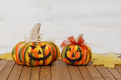 Two homemade smiling Halloween pumpkins Royalty Free Stock Images