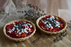 Two homemade tartellettes  with red peppers greek cheese black sesame and thyme Stock Photo