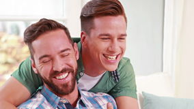 Two homosexual together. In the living room stock footage