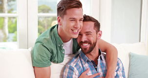 Two homosexual together. In the living room stock video footage