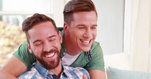 Two homosexual together. In the living room stock video