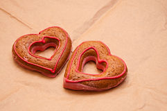 Two honey-cakes in shape of heart Royalty Free Stock Images