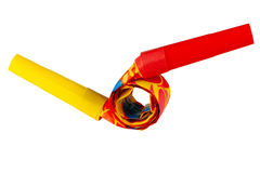 Two hooked in whistles. Colored whistles to make noise on carnival parties Royalty Free Stock Photos
