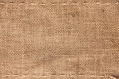 The two horizontal stitching on the burlap. As background Royalty Free Stock Images