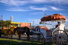 Two horse carriages stopped  in XingHai Park for tourists. Stock Photography