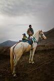 Two horsemen of Bromo volcano, Bromo, Indonesia Stock Photo