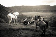 Two horsemen of Bromo volcano, Bromo, Indonesia Royalty Free Stock Photography