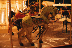 Two horses of carousel at dark evening. Two little horses of carousel at dark evening Royalty Free Stock Photo