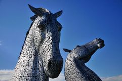 Two horses heads made of steel. Royalty Free Stock Photography