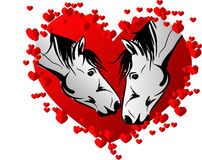 Two horses kissing in red heart Stock Images
