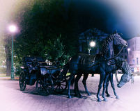 Two horses monument in Minsk Belorussia vignette background back Stock Photos