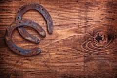 Two horseshoe on vintage wooden board close up Royalty Free Stock Photos