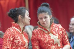 Chinese New Year 2019 - two hostesses. Two hostesses discussing during the Chinese new year celebration in the city hall premise celebrating the Chinese new year royalty free stock photo